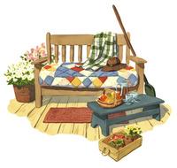 花やフルーツに囲まれたソファスペース