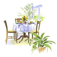 ティータイムのテーブルと向日葵