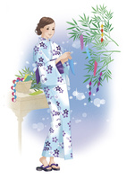 七夕の短冊を結びつける女性 02463001645| 写真素材・ストックフォト・画像・イラスト素材|アマナイメージズ