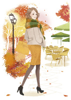 秋の街を歩く女性