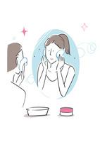 鏡に向かってスキンケアをする女性