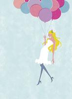 風船で空を飛ぶ女性