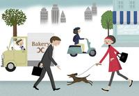 犬の散歩をする女性とサラリーマン