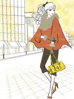 イルミネーションの街を行く女性