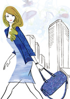 ビル街を行く女性