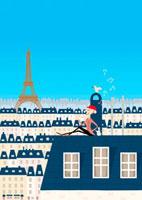 パリの屋根の上でコーヒーを飲む男性