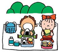 遠足でお弁当を食べている男の子と女の子
