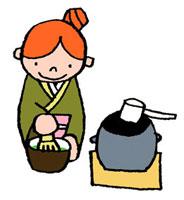 茶道で茶を点てている女性