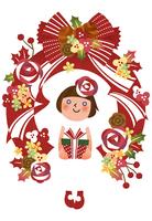 クリスマスリースの中でプレゼントを持つ女の子
