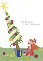 プレゼントから飛び出したクリスマスツリーと女の子