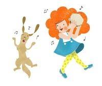 タンバリンを叩く女の子と踊る犬