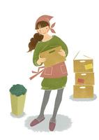 ダンボールを片付ける掃除中の女性
