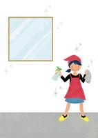 スプレーを使って窓ふきをする女の子