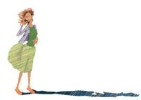 風に吹かれている女性