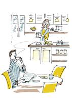 キッチンの女性と食卓の男性