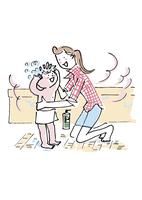 子供をお風呂に入れる女性