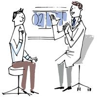 医師の説明を聞く男性