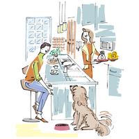キッチンでお茶をする男女と犬