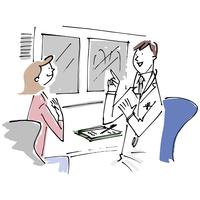 医師の説明を聞く女性