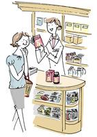 薬局で話を聞く女性客