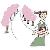 桜並木と本を抱く女性