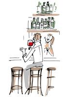 バーカウンターでワインを飲む男性