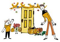 ハロウィンの飾りつけをする母と子供