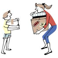 荷物を運ぶ女性と子供