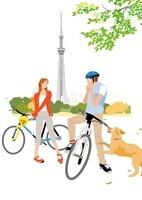 サイクリングするカップルとスカイツリー
