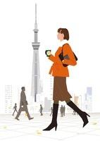 冬の出勤途中の女性とスカイツリー