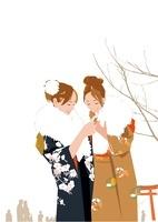 正月晴れ着姿の女性二人がおみくじを見る