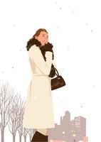 冬のコートで街を行く女性