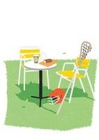 日のあたる芝にイステーブルとラクロスの道具