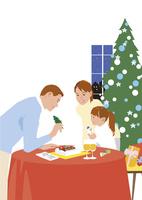 クリスマスにケーキにデコレーションする3人ファミリー