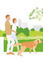街の公園を犬を連れ散布する夫婦