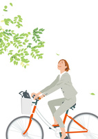 新緑を自転車で走るキャリアウーマン