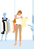 ブティックで服を選びショッピングする女性