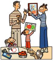 絵を飾る家族とイヌ