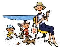 砂浜で遊ぶ親子とイヌ