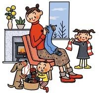 編み物をする母親と遊ぶ子供とイヌ