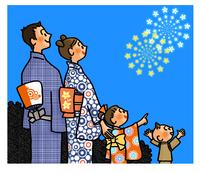 夜空に打ち上がった花火を見て喜ぶ家族