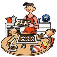 ハートのクッキーを作るお母さんと子供たち