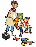 本の整理をするお母さんと子供たち