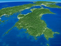 九州上空より四国地方を望む
