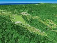 空知川と十勝岳連峰と富良野盆地の広域を望む