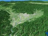 富士山西部上空から長野県へ向けて山に囲まれた甲府盆地を望む
