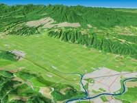 富良野盆地と十勝岳山麓を望む