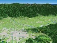 松本市上空より北アルプスを背景に松本盆地を望む