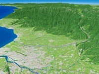 富山市西側上空から富山平野を流れる常願寺川を望む