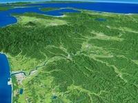 八郎潟上空から白神山地へ向けて米代川を望む